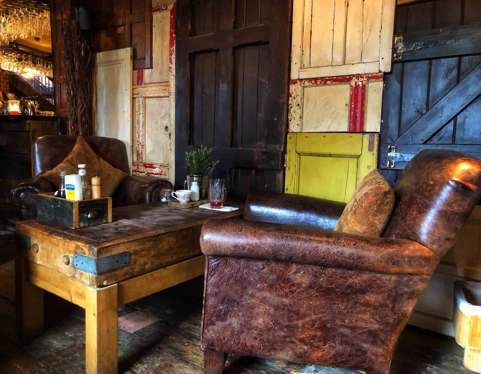 Cosy seating, leather sofas, upcycled doors